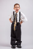 Boy wearing oversized clothes Royalty Free Stock Photography