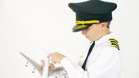 Boy wearing pilot`s uniform examines airliner scale model. Boy wearing pilot`s uniform examines airliner model stock footage