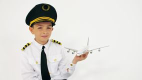 Boy wearing pilot`s uniform holds scale airliner moder. Boy wearing pilot`s uniform holds scale airliner stock video footage