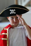 Boy wearing pirate costume. Getting ready for Halloween Stock Photo