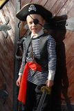 Boy wearing pirate costume. Getting ready for Halloween royalty free stock photos