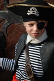 Boy wearing pirate costume Stock Photos