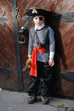 Boy wearing pirate costume Stock Images