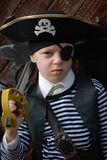 Boy wearing pirate costume. Getting ready for Halloween stock photography