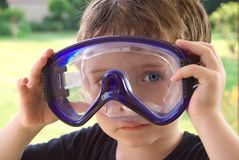 Boy wearing pool googles. Outside ata a pool party Stock Images