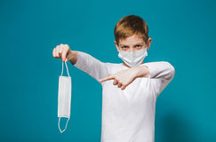 Boy wearing protection mask pointing on mask Royalty Free Stock Image