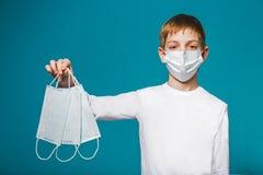 Boy wearing protection mask suggesting masks Royalty Free Stock Photo