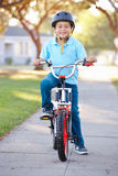 Boy Wearing Safety Helmet Riding Bike Royalty Free Stock Photography