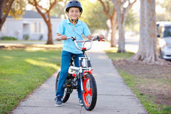 Boy Wearing Safety Helmet Riding Bike. Smiling Royalty Free Stock Images