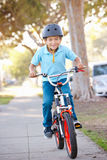Boy Wearing Safety Helmet Riding Bike. Smiling Royalty Free Stock Photos