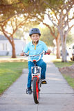 Boy Wearing Safety Helmet Riding Bike. Smiling Stock Photography
