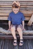 Boy wearing Sandals Stock Photos