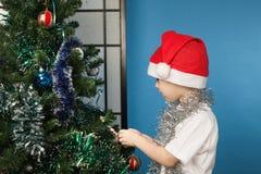Boy wearing santa claus clothes Stock Photos