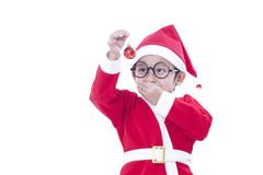 Boy wearing Santa Claus uniform Royalty Free Stock Photo