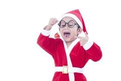 Boy wearing Santa Claus uniform Stock Images