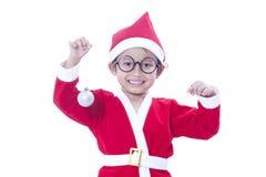 Boy wearing Santa Claus uniform Stock Photos