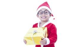 Boy wearing Santa Claus uniform Stock Photography