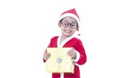 Boy wearing Santa Claus uniform Royalty Free Stock Image