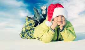 Boy wearing Santa hat Stock Photos