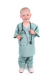 Boy Wearing Scrubs Holding a Stethoscope Stock Images