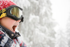Boy wearing ski goggles Stock Images