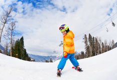 Boy wearing ski mask skiing view from back Stock Image