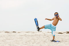 Boy wearing snorkel and flippers Stock Photo