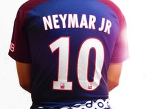 A boy wearing a soccer shirt with the name of Neymar and the number ten royalty free stock images