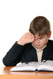 Boy wearing spectacles masses an eye for weariness Royalty Free Stock Images