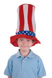 Boy wearing stars and stripes. Young boy wearing a stars and stripes patriotic top hat stock images