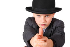 Boy wearing suit and hat is playing gangster Royalty Free Stock Photo