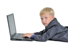 Boy wearing suit working on laptop Royalty Free Stock Photo