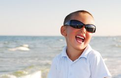 Boy wearing sunglasses by sea Stock Photo