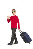 Boy wearing sunglasses walking and waving hello with travel bags Royalty Free Stock Photos