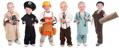 Boy Wearing Various Occupational Uniforms Royalty Free Stock Image