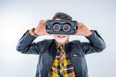 Boy wearing virtual reality headset on grey Royalty Free Stock Photos