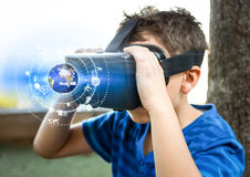 Boy wearing VR Virtual Reality Headset with Interface. Digital composite of Boy wearing VR Virtual Reality Headset with Interface Stock Photo