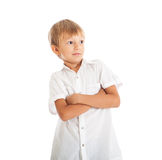 Boy wearing white shirt. A boy wearing a white shirt crossed his arms, surprised face Royalty Free Stock Image