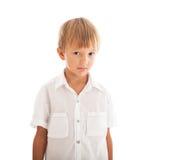 Boy wearing white shirt. A boy wearing a white shirt looking at camera Stock Image