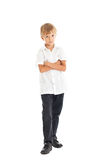 Boy wearing white shirt and black jeans. A boy wearing a white shirt and black jeans crossed his arms Royalty Free Stock Photos