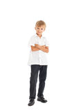 Boy wearing white shirt and black jeans. A boy wearing a white shirt and black jeans crossed his arms Stock Photo