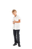 Boy wearing white shirt and black jeans. A boy wearing a white shirt and black jeans showing sing Excellent Royalty Free Stock Photo