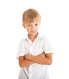 Boy wearing white shirt and black jeans. A boy wearing a white shirt crossed his arms Royalty Free Stock Photography