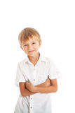 Boy wearing white shirt and black jeans. A boy wearing a white shirt crossed his arms, smiling face Stock Photos