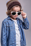 Boy wearing white sunglasses Royalty Free Stock Images
