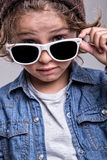 Boy wearing white sunglasses Royalty Free Stock Photos