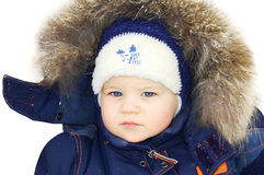Boy wearing winter clothes. On white background Royalty Free Stock Photography