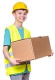 Boy wearing yellow hard hat Stock Photography
