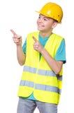 Boy wearing yellow hard hat Stock Photos