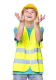 Boy wearing yellow hard hat Royalty Free Stock Images